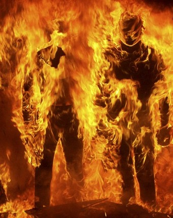 Mannequins burn during riots in the northern Greek town of Thessaloniki December 8, 2008. Protesters set fire to a major department store in central Athens and torched the city's giant Christmas tree outside parliament.