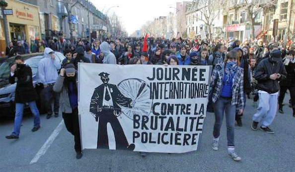 Protesters head south on St. Denis street Sunday, March 15, 2009 in Montreal during the annual march against police brutality. John Kenney.
