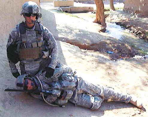1LT Pathak demonstrating how Ayala knelt on top of Salam before shooting him in the head.