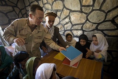 "Navy Adm. Mike Mullen, chairman of the Joint Chiefs of Staff hands out notebooks at the opening of the Pushghar Village Girls School, Panjshir Valley, Afghanistan, July 15, 2009. The school located in a remote valley 60 miles north of the capitol Kabul was built by ""Three Cups of Tea"" author Greg Mortenson to promote and support community-based education, especially for girls, in remote regions of Pakistan and Afghanistan. Photos: JCS at http://www.jcs.mil/photoessay.aspx?ID=56"