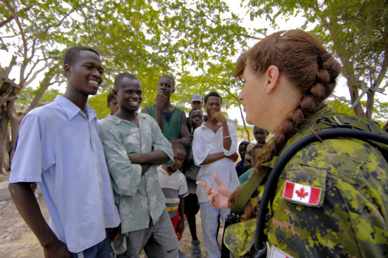 TERRE DE NEGRES, Haiti (Sept. 24, 2008) -- Canadian Forces Cpl. Eva-Marie Rogerson, currently attached to USS Kearsarge (LHD 3), talks with locals during a medical assessment survey to determine what aid will be needed for future relief efforts. Kearsarge embarked personnel from the Navy, Army, Air Force, Marines, and Coast Guard, along with medical personnel from the U.S. Public Health Service, Canadian Army, Air Force and Navy, Brazil, Project HOPE and International Aid are working together to conduct disaster relief operations in Haiti. (U.S. Navy photo by Mass Communication Specialist 2nd Class Erik C. Barker/Released)
