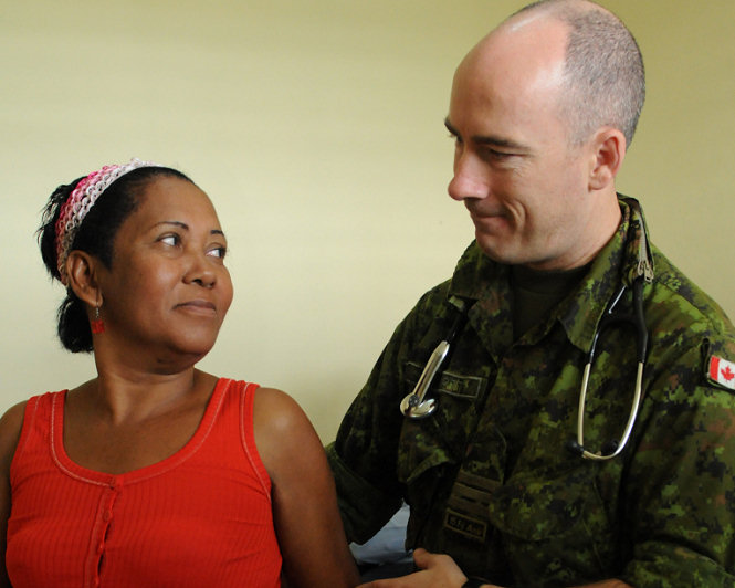 SANTO DOMINGO, Dominican Republic (Oct. 16, 2008) Canadian Air Force Lt. Col. Roger Scott, embarked aboard the amphibious assault ship USS Kearsarge (LHD 3), examines a patient at the 27 Febrero medical site during the humanitarian assistance mission Continuing Promise 2008. Kearsarge is the primary platform for the Caribbean phase of Continuing Promise, an equal-partnership mission involving the United States, Canada, the Netherlands, Brazil, France, Nicaragua, Colombia, Dominican Republic, Trinidad and Tobago and Guyana. (U.S. Navy photo by Mass Communication Specialist 3rd Class William S. Parker/Released)