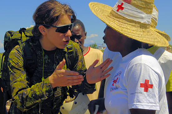 PORT AU PRINCE, Haiti (September 18, 2008) - Canadian Army Lt. Stephanie Lavoie, embarked aboard USS Kearsarge (LHD 3), speaks with members of the Haitian Red Cross regarding medical care for citizens of Haiti who were displaced by recent storms. Kearsarge is utilizing helicopters and amphibious landing craft to reach storm victims in areas of Haiti where the roads are inaccessible. (U.S. Navy photo by Mass Communication Specialist Seaman Ernest Scott)