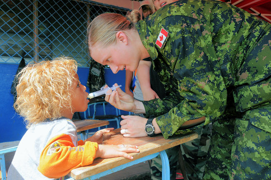 BETANIA, Nicaragua (Aug. 17, 2008) Canadian Air Force Pvt. Tabitha Beynen, embarked aboard the amphibious assault ship USS Kearsarge (LHD 3), uses a syringe to give de-worming medication into a child at the Betania medical clinic. Kearsarge is deployed supporting the Caribbean phase of Continuing Promise 2008, an equal-partnership mission involving the United States, Canada, the Netherlands, Brazil, Nicaragua, Panama, Colombia, Dominican Republic, Trinidad and Tobago and Guyana. (U.S. Navy photo by Mass Communication Specialist 3rd Class Christopher Lange/Released)