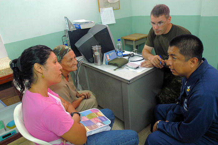 SANTA MARTA, Colombia (Aug. 29, 2008) Canadian Army Capt. Maximilian Callahan, left, speaks with patients at a Candeleria medical clinic with the help of translator Aviation Machinist Mate 1st Class Emilio Trujuillo, assigned to the amphibious assault ship USS Kearsarge (LHD 3), during the humanitarian assistance mission Continuing Promise (CP) 2008. Kearsarge is supporting the Caribbean phase of CP 2008, an equal-partnership mission between the United States, Canada, the Netherlands, Brazil, Nicaragua, Panama, Colombia, Dominican Republic, Trinidad and Tobago and Guyana. (U.S. Navy photo by Mass Communication Specialist 2nd Class Gina Wollman/Released)