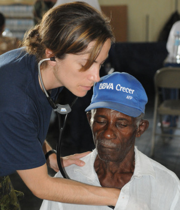 BAYAGUANA, Dominican Republic (October 5, 2008) - Canadian Air Force Capt. Jolene Cook, a medical augmentee embarked aboard USS Kearsarge (LHD 3), gives a local man a general medical examination at the El Deporte y Recreacion Derecho de la Poblacion during the humanitarian/civic assistance mission Continuing Promise (CP) 2008. Kearsarge is the primary platform for the Caribbean phase of CP, an equal-partnership mission involving the United States, Canada, the Netherlands, Brazil, France, Nicaragua, Panama, Colombia, Dominican Republic, Trinidad and Tobago and Guyana. (U.S. Navy photo by Mass Communication Specialist 3rd Class (SW/AW) William S. Parker/Released)