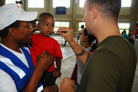 SABANA GRANDE, Dominican Republic (Oct. 15, 2008) Canadian Army Pvt. David Pivato, embarked aboard the amphibious assault ship USS Kearsarge (LHD 3), administers an anti-parasitic medication to a young Dominican boy. Kearsarge is the primary platform for the Caribbean phase of the humanitarian assistance mission Continuing Promise 2008, an equal-partnership mission involving the United States, Canada, the Netherlands, Brazil, France, Nicaragua, Colombia, Dominican Republic, Trinidad and Tobago and Guyana. (U.S. Navy photo by Mass Communication Specialist Seaman Apprentice Joshua Adam Nuzzo/Released)