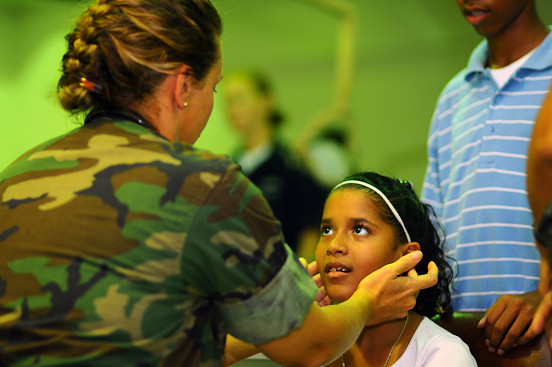 ARIMA, Trinidad and Tobago (Oct. 26, 2008) Lt. Cmdr. Kathaleen Sikes, a Navy nurse embarked aboard the amphibious assault ship USS Kearsarge (LHD 3), gives a young girl a routine check-up at the Arima District Health Facility as part of the partnership between Continuing Promise (CP) 2008 and Trinidad-Tobago. Kearsarge is the primary platform for the Caribbean phase of the humanitarian/civic assistance mission CP 08, an equal-partnership mission involving the United States, Canada, the Netherlands, Brazil, Nicaragua, Colombia, Dominican Republic, Trinidad and Tobago and Guyana. (U.S. Navy photo by Mass Communication Specialist Seaman Apprentice Joshua Adam Nuzzo/Released)