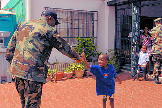 "ARIMA, Trinidad and Tobago (Oct. 26, 2008) Capt. Fernandez ""Frank"" Ponds, mission commander for Continuing Promise (CP) 2008, greets a little boy at a local children´s home during a survey of the mission sites as part of the partnership between CP 08 and Trinidad-Tobago. Kearsarge is the primary platform for the Caribbean phase of the humanitarian/civic assistance mission CP 08, an equal-partnership mission involving the United States, Canada, the Netherlands, Brazil, Nicaragua, Colombia, Dominican Republic, Trinidad and Tobago and Guyana. (U.S. Navy photo by Mass Communication Specialist 2nd Class Gina Wollman/Released)"