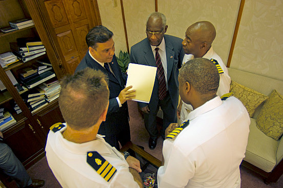 """ARIMA,Trinidad and Tobago (Oct. 27, 2008) - Capt. Fernandez """"Frank"""" Ponds, mission commander for Continuing Promise (CP) 2008 and Capt. Walter Towns, commanding officer, USS Kearsarge (LHD 3), discuss humanitarian operations with U.S. Ambassador Roy Austin and Administer of Health Jerry Narace as part of the partnership between CP 2008 and Trinidad and Tobago. Kearsarge is the primary platform for the Caribbean phase of the humanitarian/civic assistance mission CP 2008, an equal-partnership mission involving the United States, Canada, the Netherlands, Brazil, Nicaragua, Colombia, Dominican Republic, Trinidad and Tobago and Guyana. (U.S. Navy photo by Mass Communication Specialist 2nd Class Erik Barker/Released)"""