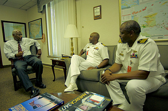 """ARIMA,Trinidad and Tobago (Oct. 27, 2008) - Capt. Fernandez """"Frank"""" Ponds, mission commander for Continuing Promise (CP) 2008 and Capt. Walter Towns, commanding officer, USS Kearsarge (LHD 3), discuss humanitarian operations with U.S. Ambassador Roy Austin as part of the partnership between CP 2008 and Trinidad and Tobago. Kearsarge is the primary platform for the Caribbean phase of the humanitarian/civic assistance mission CP 2008, an equal-partnership mission involving the United States, Canada, the Netherlands, Brazil, Nicaragua, Colombia, Dominican Republic, Trinidad and Tobago and Guyana. (U.S. Navy photo by Mass Communication Specialist 2nd Class Erik Barker/Released)"""