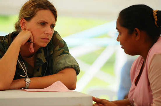 COUVA, Trinidad and Tobago (Oct. 29, 2008) Lt. Cmdr. Kathaleen Sikes, a Navy nurse embarked aboard the amphibious assault ship USS Kearsarge (LHD 3), listens to a young woman during a routine check-up at a medical clinic at the Couva District Health Facility during the humanitarian/civic assistance mission Continuing Promise (CP) 2008. Kearsarge is the primary platform for the Caribbean phase of CP, an equal-partnership mission involving the United States, Canada, the Netherlands, Brazil, Nicaragua, Colombia, Dominican Republic, Trinidad and Tobago and Guyana. (U.S. Navy photo by Mass Communication Specialist Seaman Apprentice Joshua Adam Nuzzo/Released)