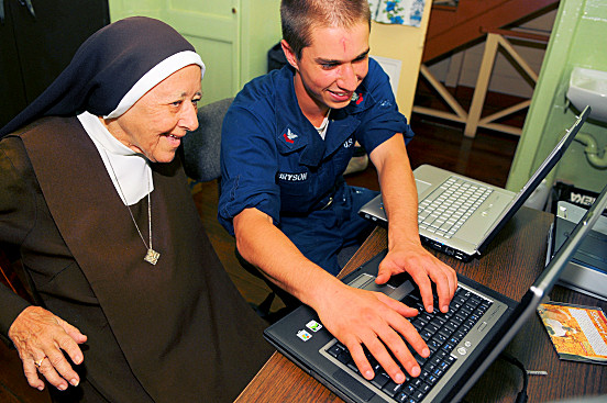 BELMONT,Trinidad and Tobago (Nov. 3, 2008) Information Systems Technician 2nd Class Andrew Bryson, assigned to the amphibious assault ship USS Kearsarge (LHD 3), teaches Sister Helena of the Carmelite Sister Convent how to use the Internet. Kearsarge is the primary platform for the Caribbean phase of the humanitarian assistance mission Continuing Promise 2008. U.S. Navy photo by Mass Communication Specialist Seaman Apprentice Joshua Adam Nuzzo (Released)