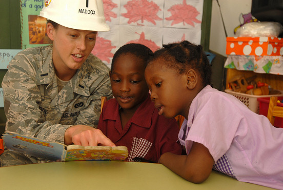 PORT OF SPAIN, Trinidad and Tobago (Oct. 30, 2008) 1st Lt. Lindsey Maddox, embarked aboard the amphibious assault ship USS Kearsarge (LHD 3), reads to children from the All in One Child Development Center, a local daycare where engineers embarked aboard Kearsarge are making renovations supporting Continuing Promise (CP) 2008. Kearsarge is the primary platform for the Caribbean phase of the humanitarian/civic assistance mission CP 08, an equal-partnership mission involving the United States, Canada, the Netherlands, Brazil, Nicaragua, Colombia, Dominican Republic, Trinidad and Tobago and Guyana. (U.S. Navy photo by Mass Communication Specialist 2nd Class Gina Wollman/Released)