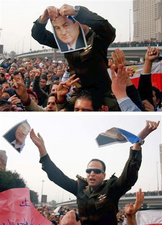 EGYPTIAN ARMY OFFICER TEARS UP A PORTRAIT OF HOSNI MUBARAK