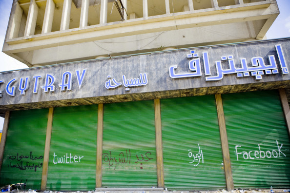 MSM, Social Media and the Egyptian Revolution--Graffiti on one of the buildings in Tahrir Square: Twitter, Al-Jazeera, Facebook
