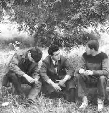 Photo, Susan Shaffer, 1964: Sergio, center, an immigrant from Rumania and another ulpan student, sitting with me under olive trees outside Susan's and my apartment. We had epic conversations in a mix of Hebrew, English, German and French, Kibbutz Dafna, 1964.