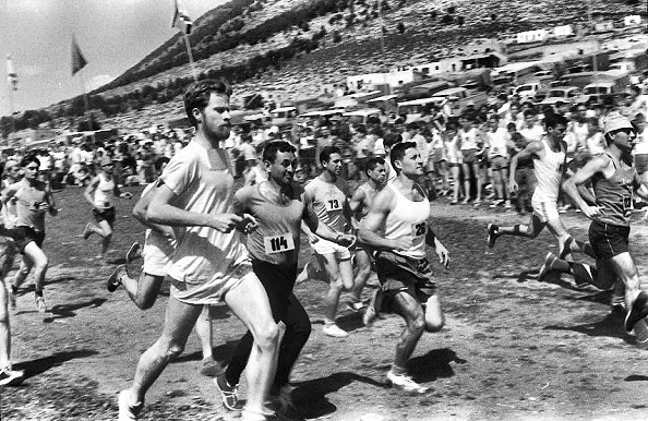 Photo, Susan Shaffer, 1964: the 10Km race around Mt Tabor in the Upper Galilee Valley. Most of the competitors are male kibbutzniks, except for me, foreground. The Palestinian village in the background is a non-entity.