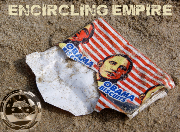 """On a beach in Ghana, a discarded wrapper for """"Obama Biscuits,"""" produced in Ghana to mark Obama's visit in 2009."""