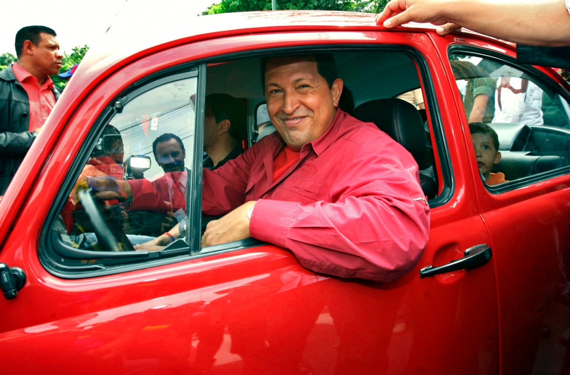 File photo of Venezuela's President Hugo Chavez driving away in a Volkswagen Beetle after voting in the presidential election at a school in Caracas