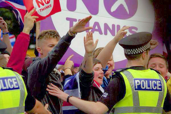 Loyalists in an apparent Nazi salute.