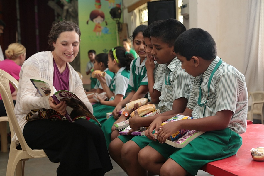 U.S. Navy Lt. Shayna Rivard, left foreground, a battalion surgeon attached to Combat Logistics Battalion 13, 13th Marine Expeditionary Unit, reads to students of the Bal Bhavan School in Panaji, Goa, India, Oct. 1, 2013, during a volunteer outreach as part of exercise Shatrujeet 2013. Shatrujeet is an annual training exercise conducted by U.S. and Indian service members to share knowledge and build interoperability skills. (DoD photo by Sgt. Christopher O'Quin, U.S. Marine Corps/Released)