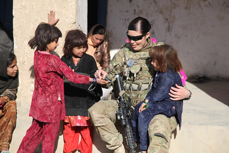 U.S. Army Staff Sgt. Christina Gedney, right, with the 116th Infantry Battalion Female Engagement Team (FET), interacts with children in Qalat, Zabul province, Afghanistan, Dec.8, 2011. The FET issued school supplies and provided support to the children and women and discussed security procedures with Female Afghan Police personnel. (DoD photo by Spc. Crystal Davis, U.S. Army/Released)