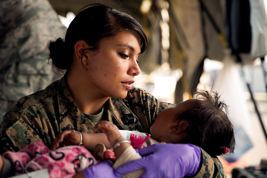 U.S. Navy Hospital Corpsman 2nd Class Jessica Gomez, from Carey, Idaho, cares for an injured child in a triage at the Tribhuvan International Airport in Kathmandu, Nepal, May 12. The child is a victim of a 7.3 magnitude earthquake that hit Nepal May 12 following a 7.8 earthquake that struck Nepal April 25. Gomez is part of Joint Task Force 505 participating in Operation Sahayogi Haat. (U.S. Marine Corps photo by Lance Cpl. Mandaline Hatch/Released)