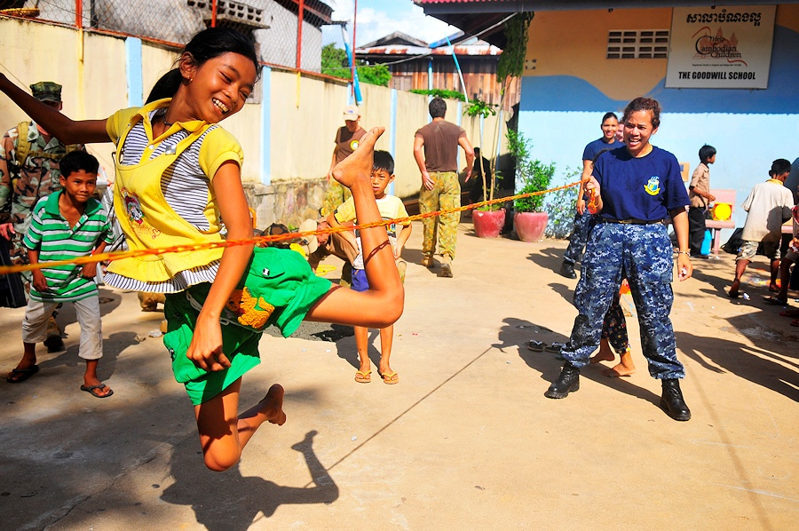 A Cambodian child plays jump rope with a U.S. Sailor from USNS Mercy (T-AH 19) during a community service event at Goodwill School in Sihanoukville, Cambodia, June 17, 2010. Mercy is deployed as part of Pacific Partnership 2010, the fifth in a series of annual U.S. Pacific Fleet humanitarian and civic assistance endeavors to strengthen regional partnerships. (DoD photo by Mass Communication Specialist 2nd Class Jon Husman, U.S. Navy/Released)