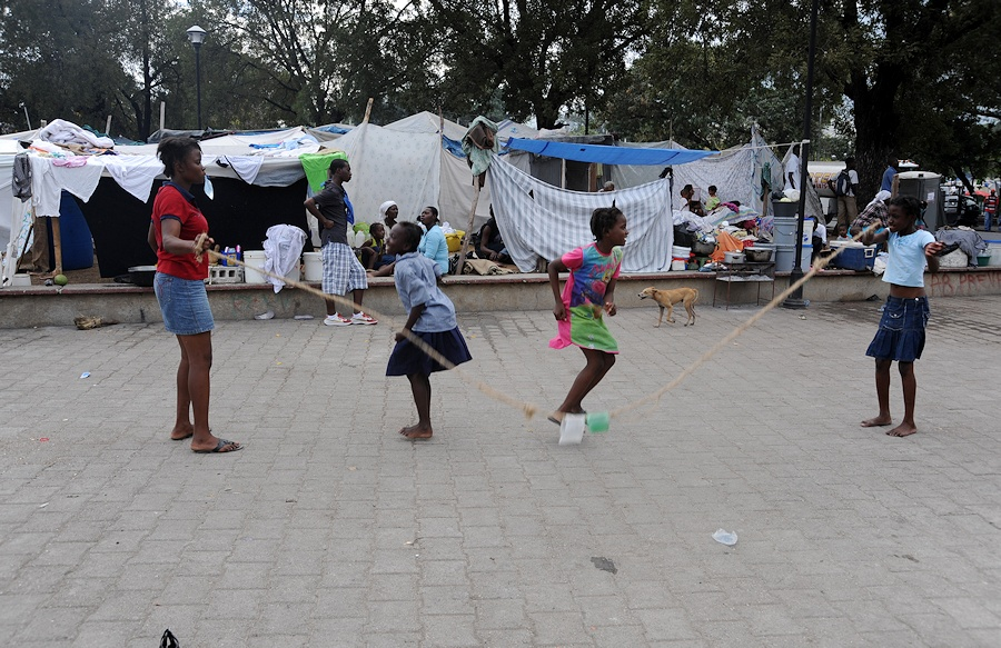 Displaced Haitians girls jump rope in a tent city near the Presidential Palace in Port-au-Prince, Haiti, Jan. 26, 2010. Members of the Department of Defense and the U.S. Agency for International Development are in the area conducting Operation Unified Response to provide aid and relief to Haitian citizens affected by the 7.0-magnitude earthquake that struck the region Jan. 12, 2010. (U.S. Air Force photo by Tech. Sgt. Prentice Colter/Released)