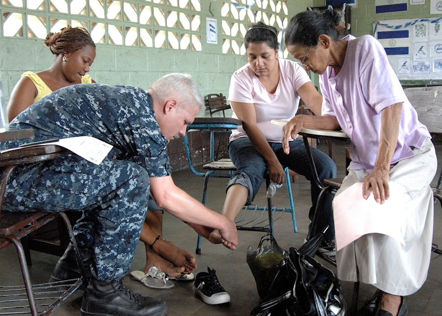 U.S. Navy Cmdr. Tim Burgis, embarked aboard the multipurpose amphibious assault ship USS Iwo Jima (LHD 7), looks at a patient?s foot at a medical site in Bluefields, Nicaragua, Sept. 17, 2010. Iwo Jima is anchored off the coast of Nicaragua in support of the Continuing Promise 2010 humanitarian civic assistance mission. (DoD photo by Mass Communication Specialist 1st Class Eric J. Rowley, U.S. Navy/Released)