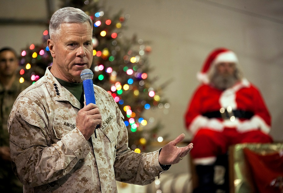 U.S. Marine Corps Gen. James F. Amos, left, the commandant of the Marine Corps, speaks to Service members during a Christmas Eve show at Camp Leatherneck, Helmand province, Afghanistan, Dec. 24, 2012. (DoD photo by Staff Sgt. Ezekiel R. Kitandwe, U.S. Marine Corps/Released)